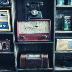 Shelves filled with old radios