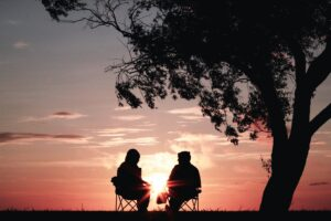 Two people looking at a sunset